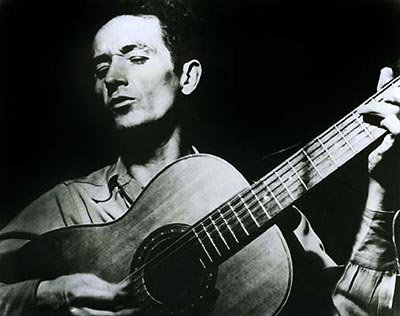 http://hahamusic.files.wordpress.com/2007/08/woodyguthrie.jpg